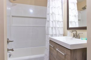 Shower curtains open in bathroom