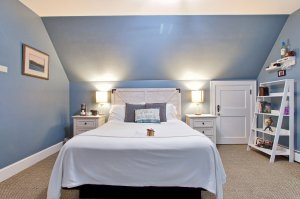 Pillows against headboard of bed next to bedside table
