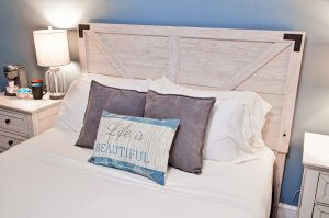 bed with monogrammed pillows
