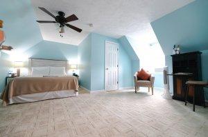 Open closet infront of rug in bedroom