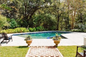 Swimming pool and patio behind house