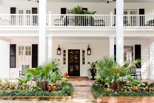 Front porch with garden plots and balcony above