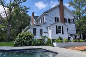 pool near an elegant manor house