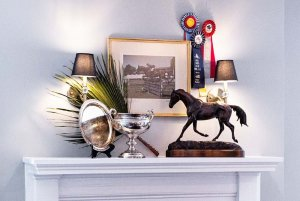 Equestrian displays and trophies on mantle