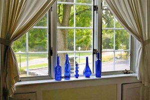 Blue glass bottles in window