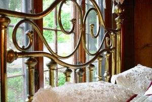 Gold scrolls on iron bed