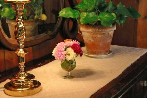 Small flowers and a brass candlestick