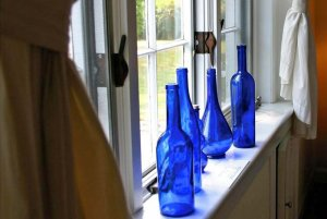 Blue glass bottles on a windowsill