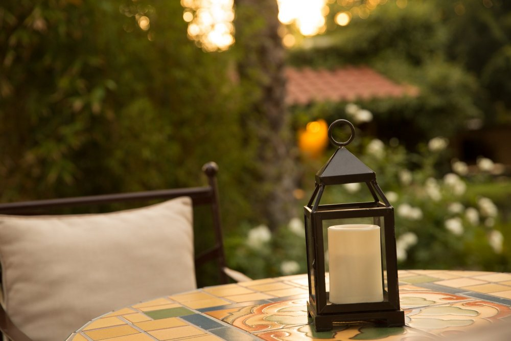 A lantern on an outdoor table
