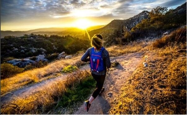 A trail runner at sunrise