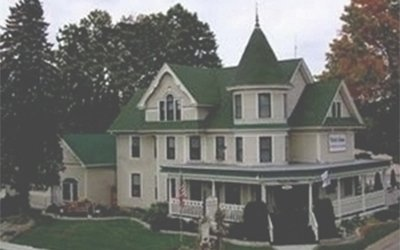 Large house with tower and porch