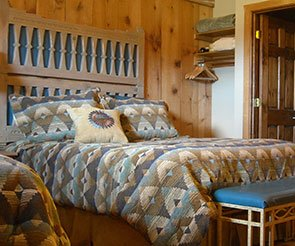 Bed at Trappers Rendezvous Guest Cabins in Williams, Arizona