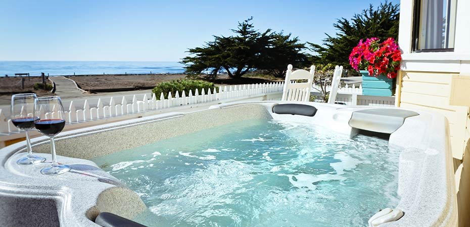 Hot tub and beach view from the Studio Suite at White Water Inn