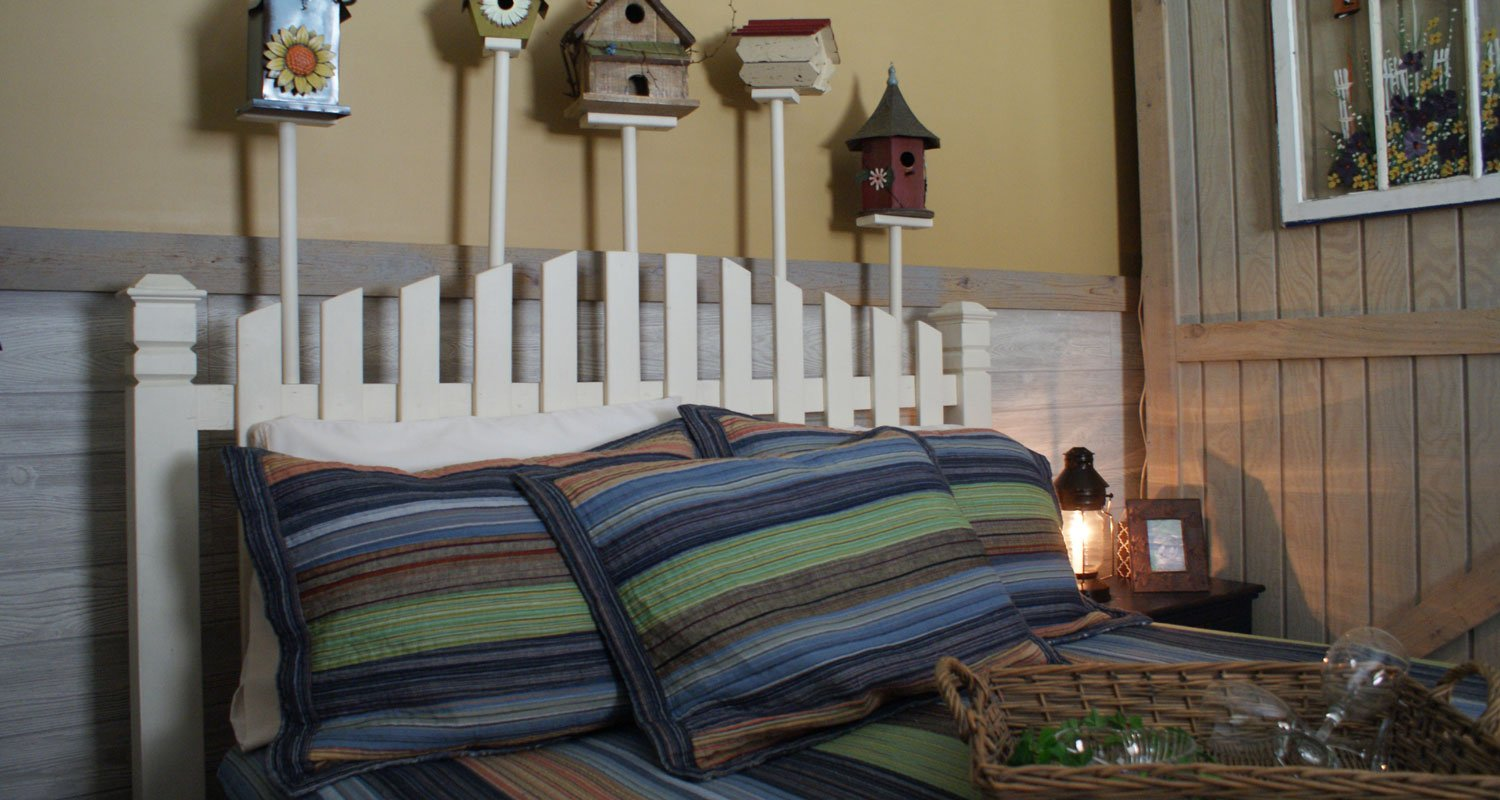 Birdhouse headboard with a welcome tray on the bed