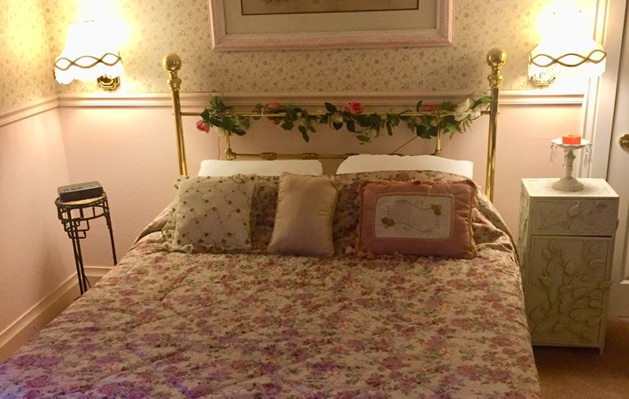 Bed with rose decorations entwined on frame