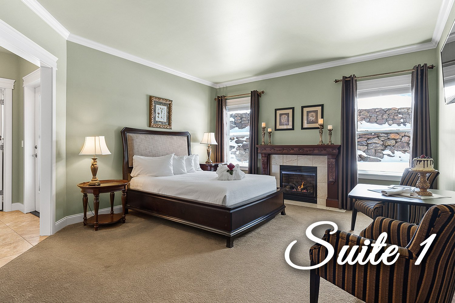 Suite 1 Bed with fireplace and end tables