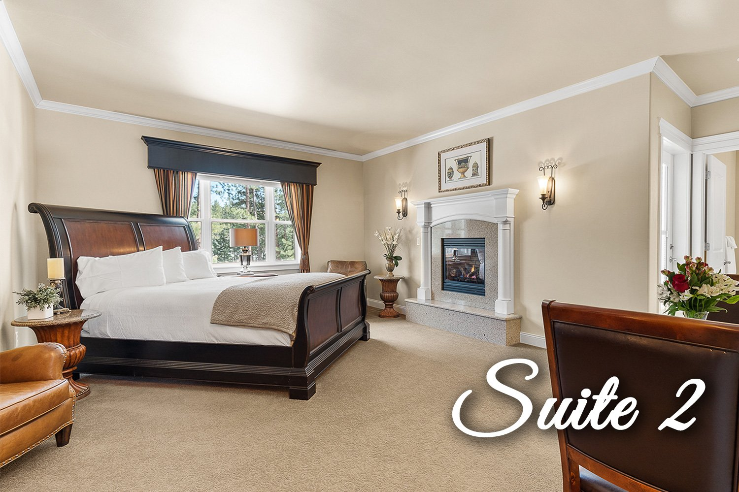 Suite 2 Bed and fireplace with chairs