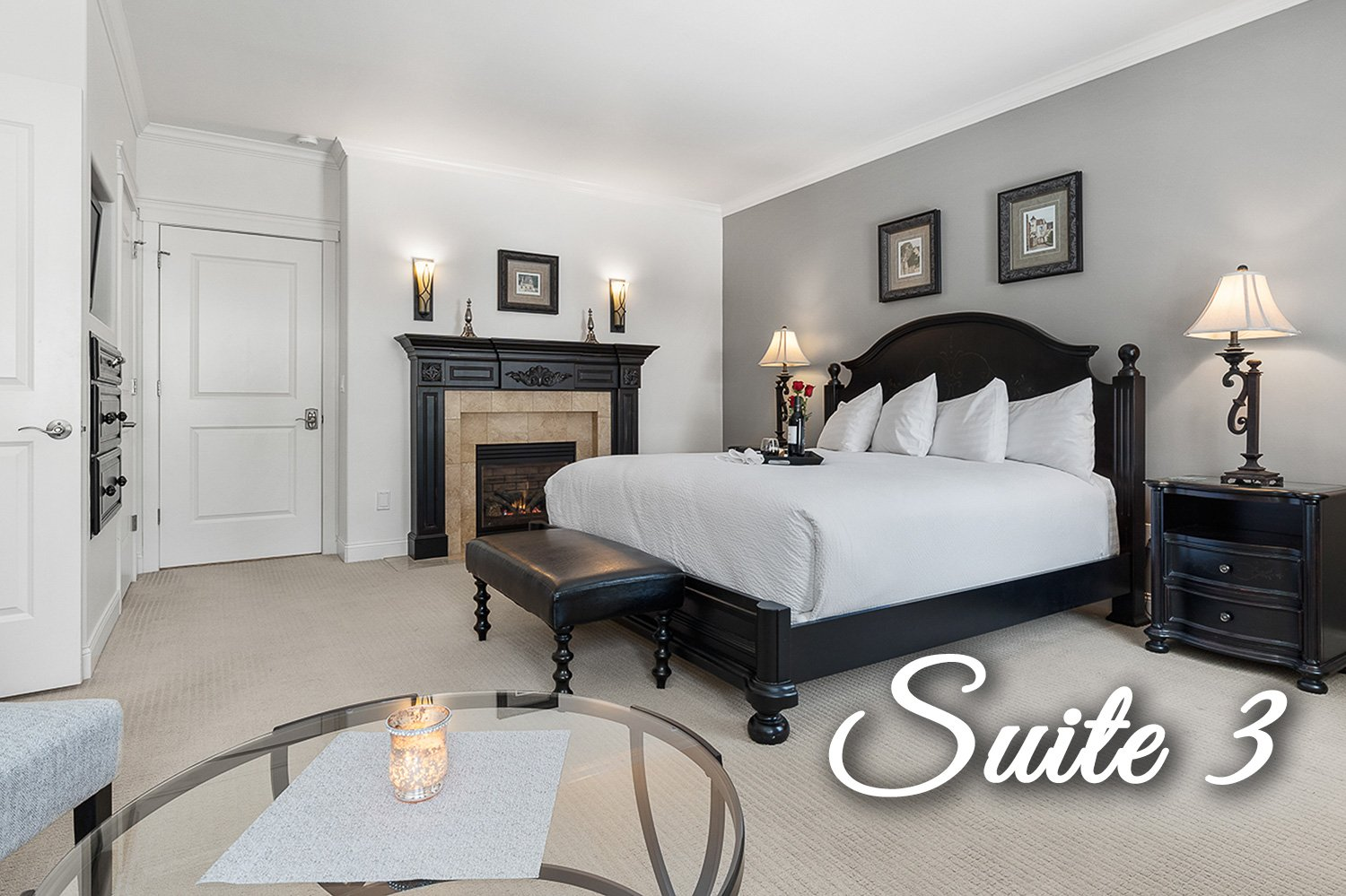 Suite 3 at Bed with chairs and fireplace