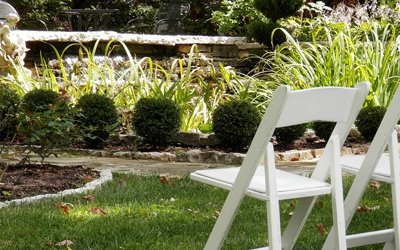 Lawn chairs near landscaping beds