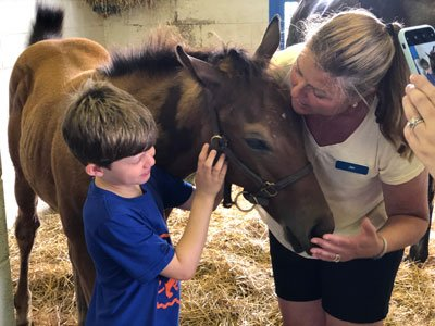 Conner and Jan with a foal
