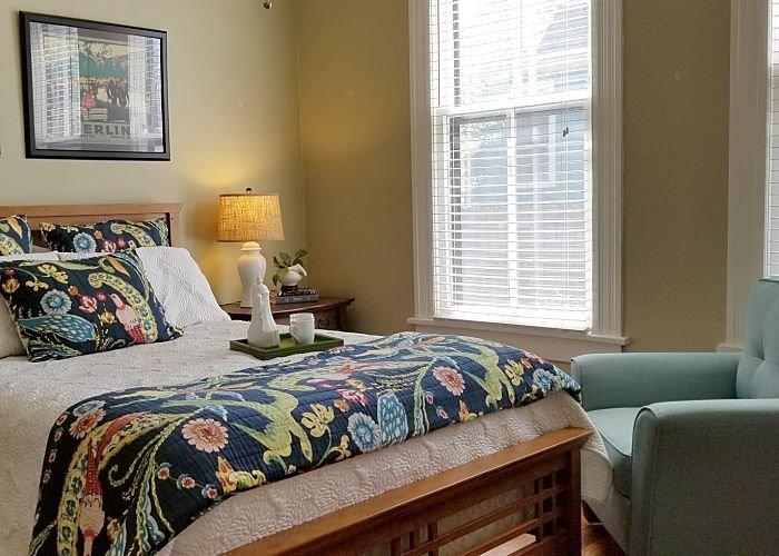 Bedroom with night table and garden view