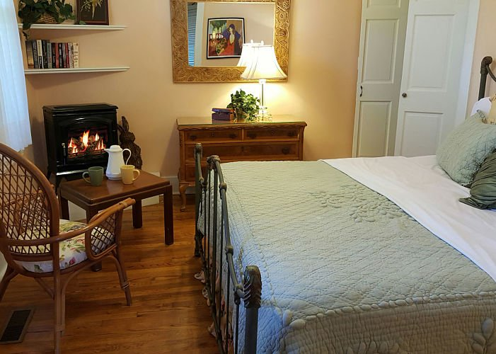 A bed with fireplace