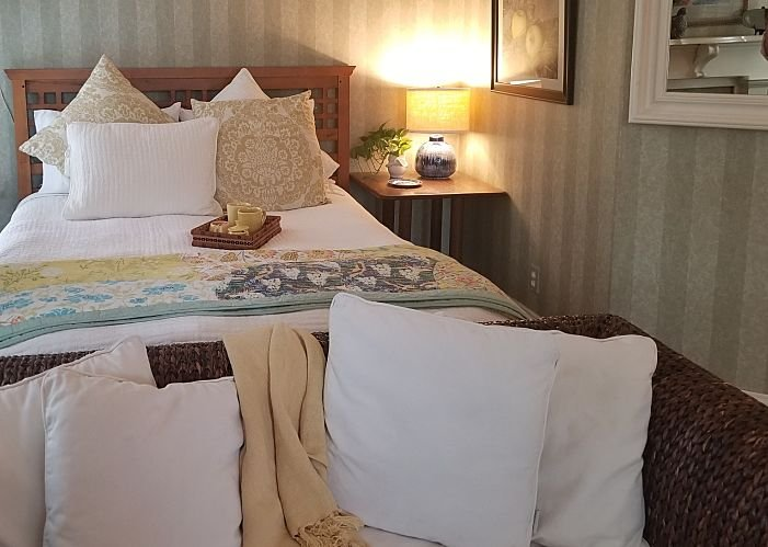 Bedroom with a side table and lamp