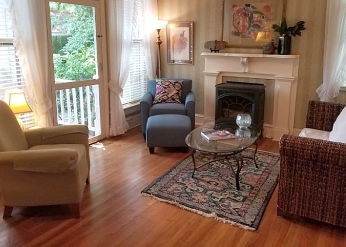 A sitting area with end table and lamp