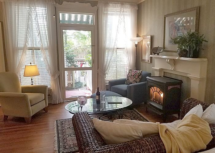 A Bed with a loveseat and fireplace