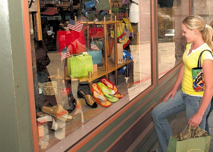 A woman looking at shoes for sale