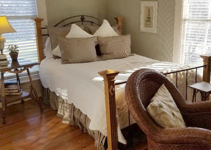 A bed with side tables and lamps