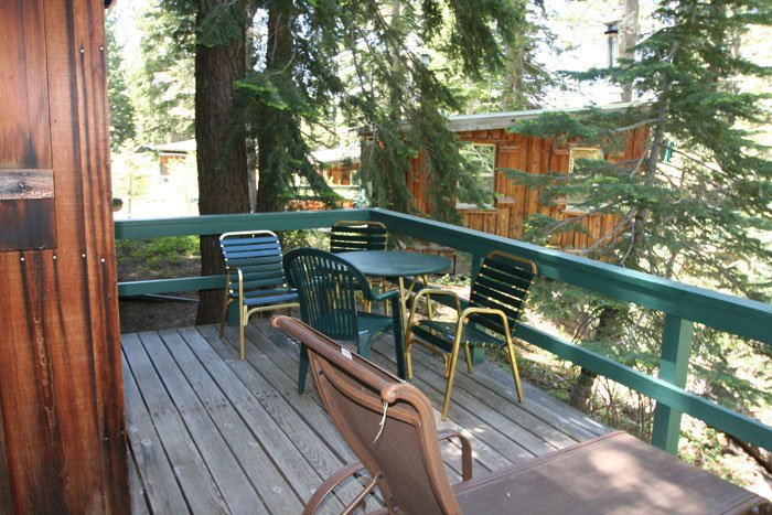 Chairs and a table on a deck