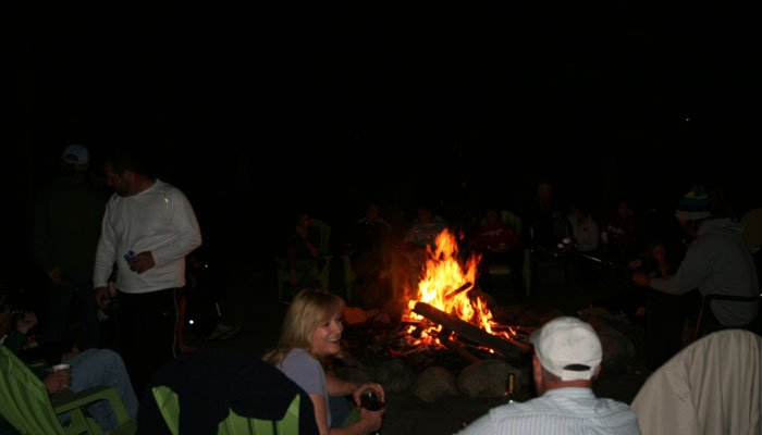 People talking around a campfire