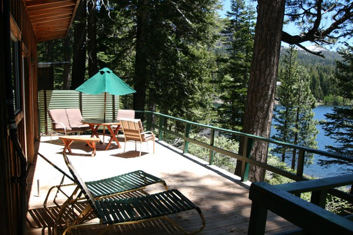 Chairs on a wooden deck overlooking a lake