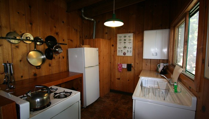Kitchen with fridge, sink, and stove