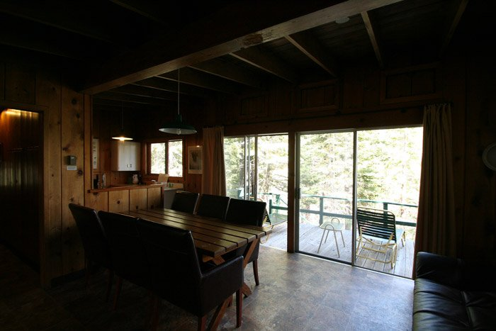Table and chairs near glass door to outside deck