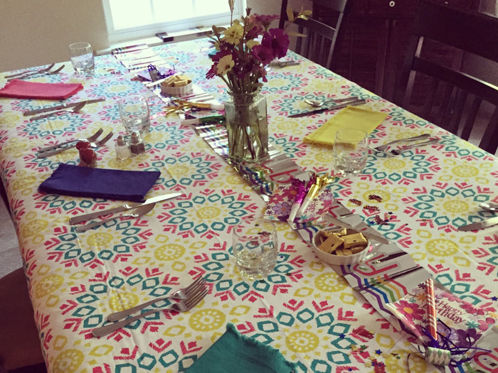 A set table with festive tablecloth