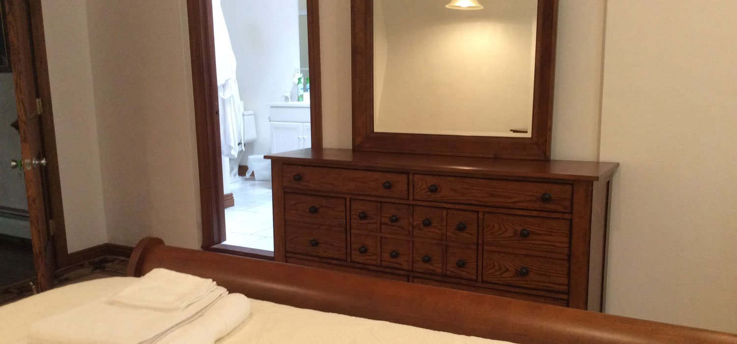 bathroom and armoire with mirror