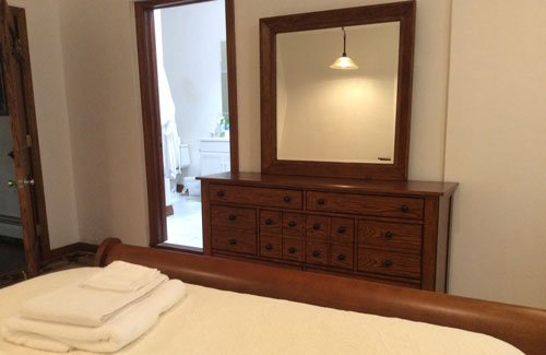 Bed and armoire with mirror