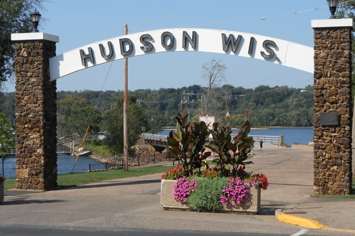 Archway over road reading Hudson Wis.