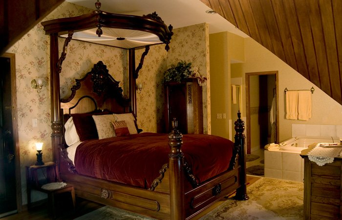 Decoratively carved poster bed