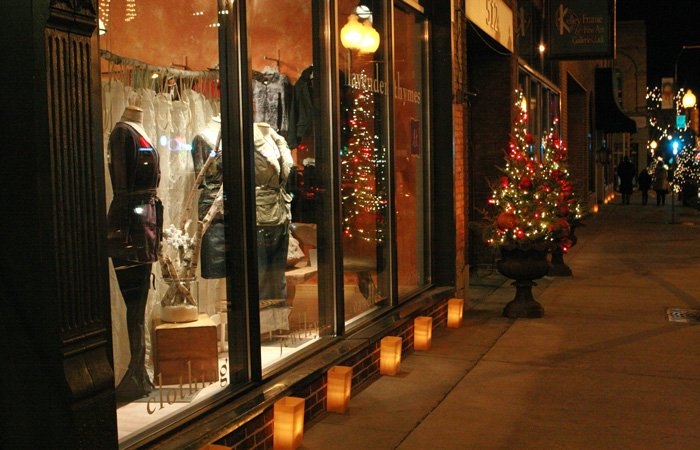 Window displays of a clothing store at night