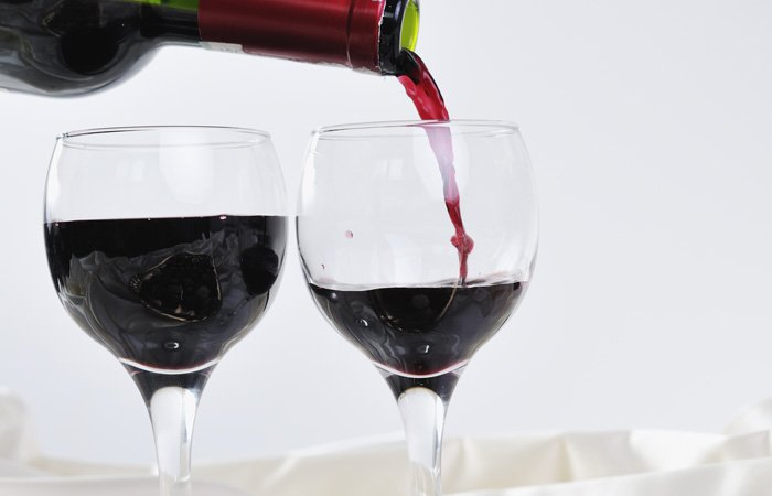 pouring two glasses of red wine