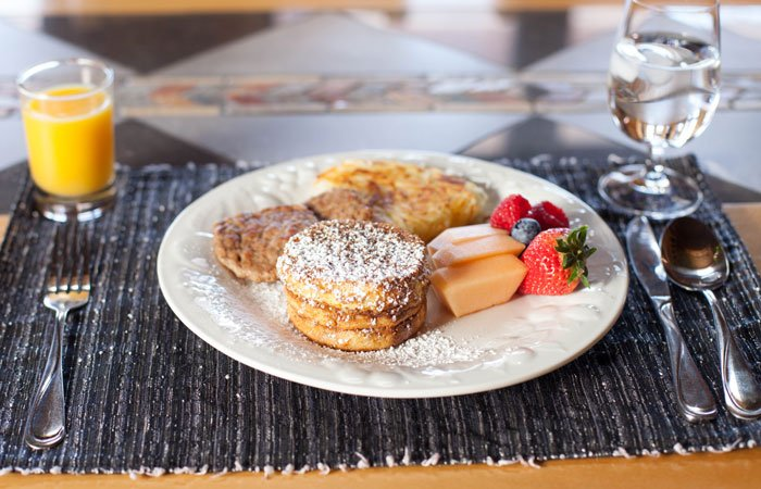 French toast with sausage and fruit