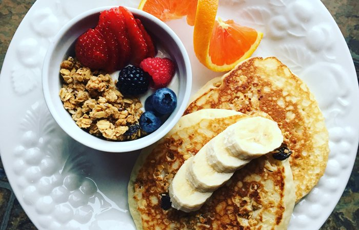 Granola, pancakes, and fruit