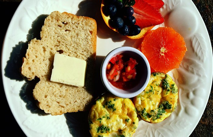 Buttered bread, fruit, and mini-omelettes