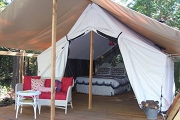 Large tent with queen-bed and couch  inside