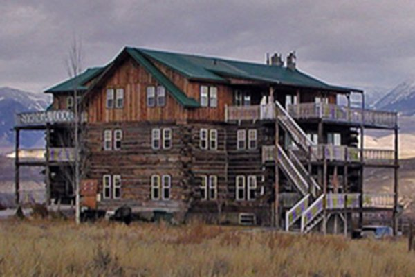 4-floor wood lodge with balconies and staircases