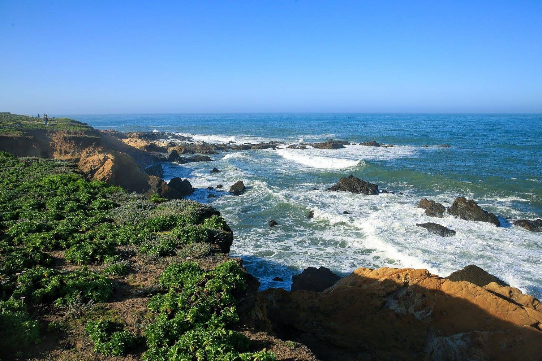 ocean crashing on cliffs
