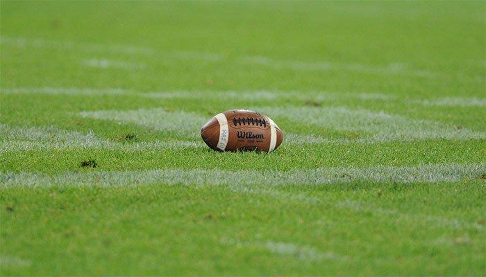 An American football on a grass field